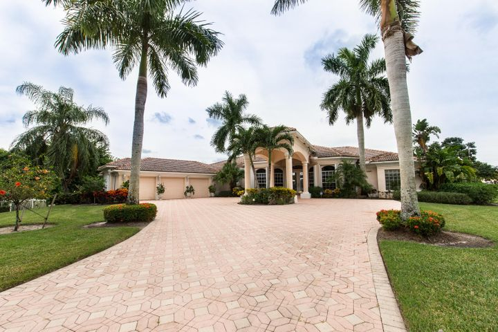 Spacious 4 bedroom + office pool home on a 1 acre lakefront Estate lot located in prestigious Bay Hill Estates. Golf & tennis memberships available through PGA National. All secondary bedrooms are En suite with their own bathrooms.
