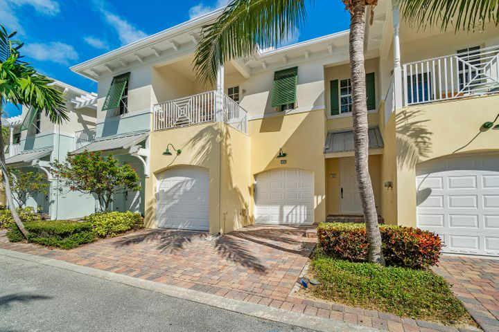 LOCATION, LOCATION, LOCATION! Meticulously maintained and upgraded 3 bedroom, 2-car garage town home located in the heart of Juno Beach, 30 feet above sea level, east of US 1, close to the beach, restaurants and shops. This friendly neighborhood of 19 town homes built in 2005 features metal roofs, hurricane impact doors and windows, private fenced yards, balconies and a community pool with changing facility. This stunning townhouse is one of only a limited number with two garages. Enjoy cooking and entertaining in the upgraded gourmet kitchen with custom cabinets and stainless steel appliances. Custom crown moldings and bamboo floors round out the interior upgrades on the first floor. Savor the ocean views while sipping cocktails on your upstairs balcony. The oversized master bedroom includes sitting area, custom built-ins and peek-a-boo ocean views. Unit also includes central vac, 2018 A/C unit and 2015 water heater.