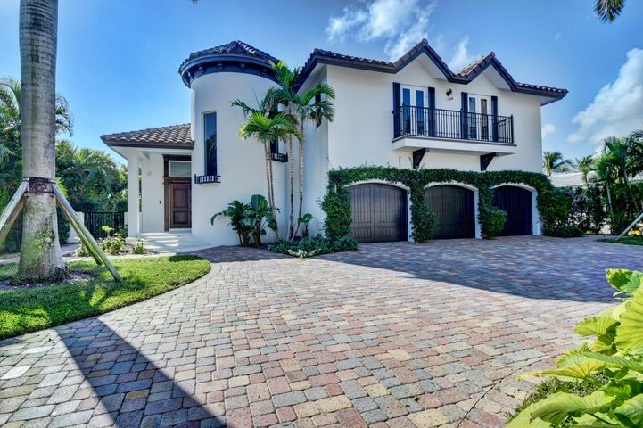 Welcome to this brand new stunning Waterfront Estate fully furnished with luxurious furnishings in East Delray & just two homes from the Intracoastal with SE exposure. It boasts 75ft of deep water, a dock for the boating lifestyle and is just one block from the Beach. The decorative driveway sets up the ambiance to come in this stately 2 story Smart Home with its mahogany entrance doors, marble flooring, custom molding, hand carved custom cabinets, wrought iron staircase and views of the pool & waterway just beyond. The gourmet kitchen was custom designed to be functional but also beautiful with its custom cabinets & spacious island with bar seating & top of the line appliances. The master suite has volume ceilings, walk-in closet, marble master bath & French doors that open up to the spacious balcony.