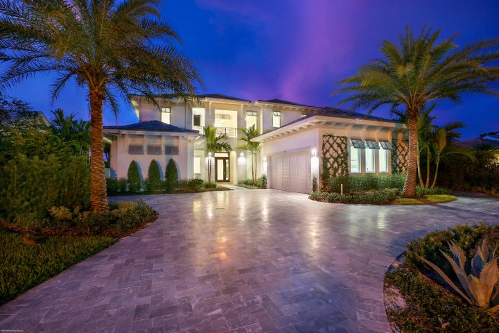 """This newly constructed Contemporary British West Indies beauty is located in prestigious Admirals Cove and is filled with modern flair and luxury finishes throughout. This 5BR/6.5Bth home is located close to the Club at the end of a cul-de-sac and offers wide/panoramic water views. Enter through a dramatic foyer and behold the stunning water views surrounding the great room with floor-to-ceiling linear gas fireplace, custom bar w/ wine-cooler and pocket sliding doors open to the patio/pool area. The chef's kitchen is a stunning place to gather and comes equipped with custom cabinetry, quartz countertops, two large prep islands, a Miele appliance center (including dual ovens, microwave & coffee station), Wolf six-burner gas cooktop w/ vent, Scotsman Ice-Maker and 48'' Sub-Zero Refrigerator/ Freezer. A luxury chandelier hangs from a designer wood-beam ceiling and dazzles your guest in the waterfront dining room. The first floor master suite offers dramatic his & hers master bathrooms w/ electric Toto toilets, custom cloud ceiling, enormous walk-in closets and large glass doors open to the patio/pool area. The stainless steel staircase w/ wood stain steps will take you to the second floor bridge leading to three large en suite bedrooms (One VIP suite w/ balcony), laundry room and morning bar. Additional interior features include 36""""x36"""" Taj Mahal floors, designer fixtures, elevator, state of the art security system, icynene insulation, downstairs laundry room with washtub & plenty of cabinet space and hurricane windows and doors throughout.  The exterior features of the home offer a circular drive with gray natural stone, lush tropical landscaping, covered patio with summer kitchen, marble pavers, vanishing edge saltwater pool with heated spa, outdoor shower and a Azek composite sundeck & dock lead to your boat with some of the best water views in Admirals Cove.  This never before lived in home is the ideal home to entertain in, S. Florida style!!!"""