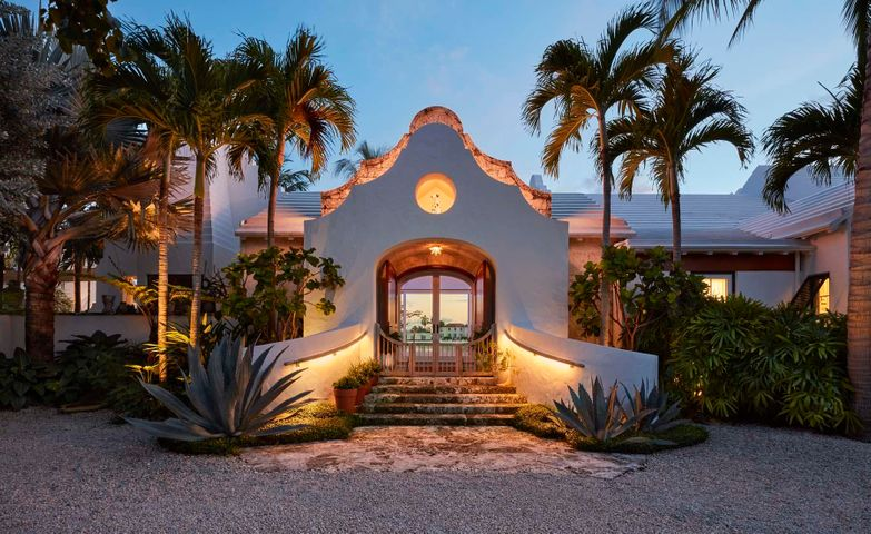 Authentic Bermudian-style house with 232' of rare south facing Intracoastal frontage and golf course views. Built for entertaining, the house won the 2017 Schuler Award from the Preservation Foundation for outstanding new architecture, as well as an AIA award for excellence in design. The large master suite incorporates a dressing room and two spa quality bathrooms as well as a sitting room and fully equipped gym. The property features a whole house generator, garage space for five cars, full smart home technology, a water purification system, retractable glass walls, lush mature landscaping and numerous other highly detailed architectural touches that make this spectacular home truly unique.