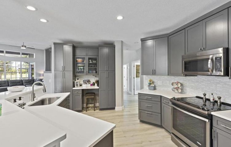 Nicely Upgraded Kitchen with Quartz Counter Top and Soft-Close Cabinetry