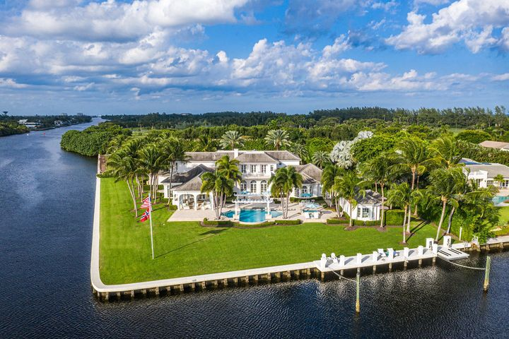 One of Gulf Stream's most desirable addresses, commanding a southern point lot view from nearly every room this Hamptonesque waterfront estate, designed by Randall Stofft, is situated on a rare one acre plus lot, encompassing over 470' of frontage and embracing the tenants of coastal living at its best.  With a warm feeling of belonging and a gracious layout with panoramic water views the estate is comfortably spacious with 6 en suite bedrooms, 7 full baths, first floor master, epicurean kitchen with informal dining surrounded by water, sun filled family room, State of the Art Home theatre, formal dining room, dual offices, exercise room, massage room, loft area, guest house, five star resort pool, entertaining loggia with outdoor kitchen, 3 bay garage and a yachtsman's dock, all seamlessl integrated into 12,567 total square feet.  This Jewel in the Crown estate is just moments from the pristine sandy beaches, upscale shopping and restaurants, and many exciting diversions. Close to international airports for easy access. Your favorite part of going out will be coming home to your sumptuous estate. Don't miss this rare opportunity!