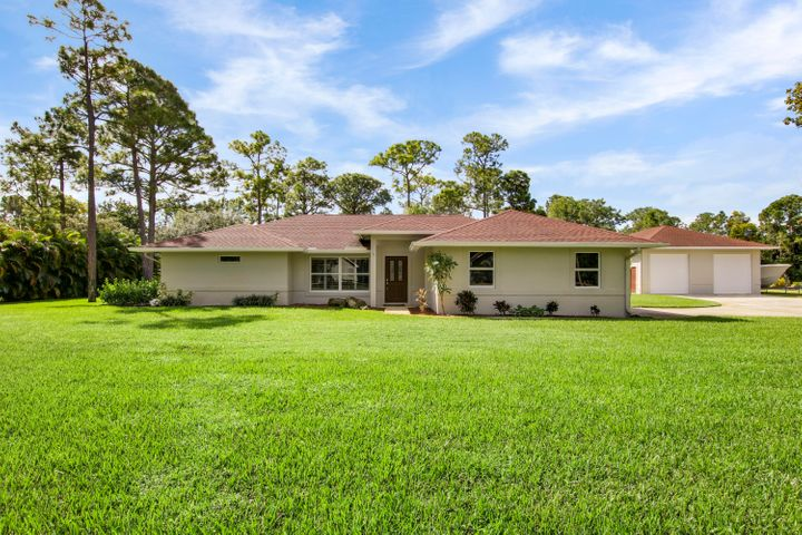This beautiful 1.5 acre property has it all! Not only has this CBS pool home been completely remodeled in 2018/2019, but it also features a detached 1,200sq ft CBS build air conditioned workshop with room for boat storage. Located on a paved road in desirable Jupiter Farms, this 4BD/2BA home shows like a new build with no details overlooked. Boasting 2,193sq ft of beautiful finishes, impact windows and doors, a stunning huge chef's kitchen, open concept living, and a split floor plan, this remodel leaves nothing to be desired. Spend your days relaxing in the picturesque pool and spa, or enjoy entertaining outdoors in your spacious backyard.Call today to schedule your appointment today.
