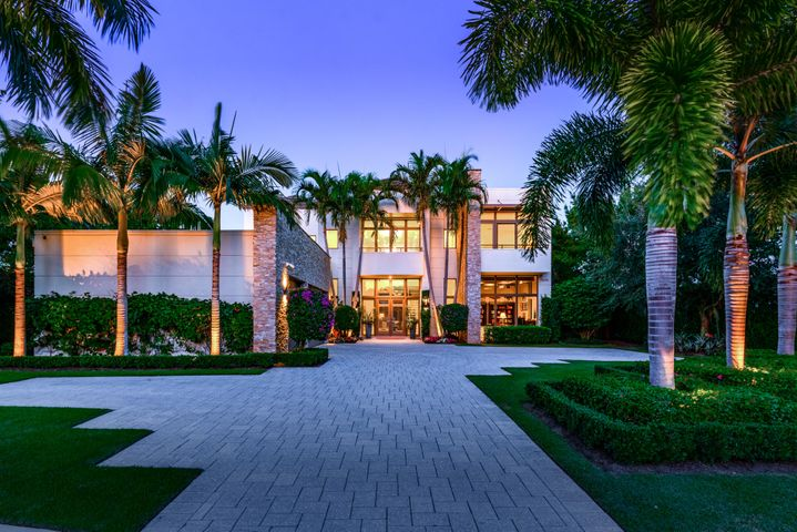 Custom Waterfront Estate directly on the Intracoastal Waterway located in the exclusive gated community of Harbor Place. This modern residence features 5 bedrooms, 5.1 baths, 3 car garage & 6,760 AC SF with panoramic water views on 1/2 acre, boat dockage & spectacular location on both land & sea. Built in 2015 by premier custom builder, Couture Homes, this house was constructed with the highest quality materials & finest workmanship with strict attention to detail. As the model home for Harbor Place, this residence showcases reinforced CBS with tie-beam construction & poured concrete, Anderson impact-resistant doors & windows, custom over-sized marble & wood flooring, custom gourmet kitchen, custom wood cabinetry & marble counters, Subzero & Wolf Appliances, luxurious master suites on each floor, 2 spectacular natural gas fireplaces, elevator, designer pool & spa, large covered loggia & summer kitchen, state-of-the-art security system tied in with smart house technology that controls the lights, music, tv, entertainment, ACs from your smart device anywhere in the world. Other features include a over-sized AC 3 car-garage, meticulous landscaped grounds with nightscape lighting & irrigation system, a full house generator, & private dock with 16,000 lb boat lift directly on the Intracoastal with deep water access. Luxury Interior Designer Pauline Hartogh out-did herself with this very clean & elegant modern style. Nothing but the highest quality materials & craftsmanship were used, including custom stone pieces in each of the fireplaces in both master suites, the backsplash behind the 8-burner Wolf range, & in the powder room. Other luxury upgrades include a custom swimming pool & spa & Lutron outdoor lighting, & over-sized outdoor living area to take full advantage of the Florida waterfront lifestyle, as well as custom built-in shelving, wall covers & much more. Harbor Place is one of the premier luxury communities in all of south Florida, tucked in between The Bear's