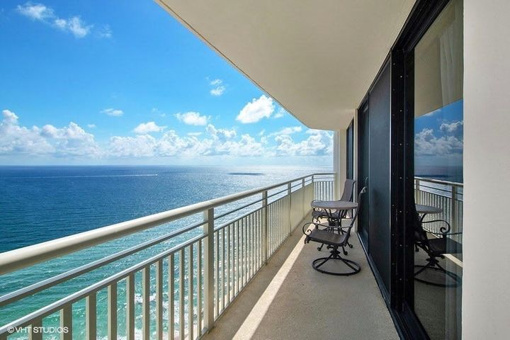 Coveted Tiara F floor plan on one of the highest floors features unobstructed direct oceanfront views & endless intracoastal vistas. Balcony access from living room and both bedrooms. Split BR floor plan. Granite & stainless appliances in kitchen. Washer/dryer inside unit. OK to purchase with tenant in place through 10/14/20. Ample closet space. Tiara is a luxury amenity building offering a true resort lifestyle, valet & 24/7 concierge, manned gate. A 1 BR suite is available for guests. Amenities include heated pool w/ tropical landscaping, separate jacuzzi, tennis, men's & women's fitness centers w/steam & sauna, billiard room, library, & card room. Beachside restaurant for eat-in or delivery. Marquis lounge on 43rd floor exclusive for residents. 15 mins to world class dining & shops.