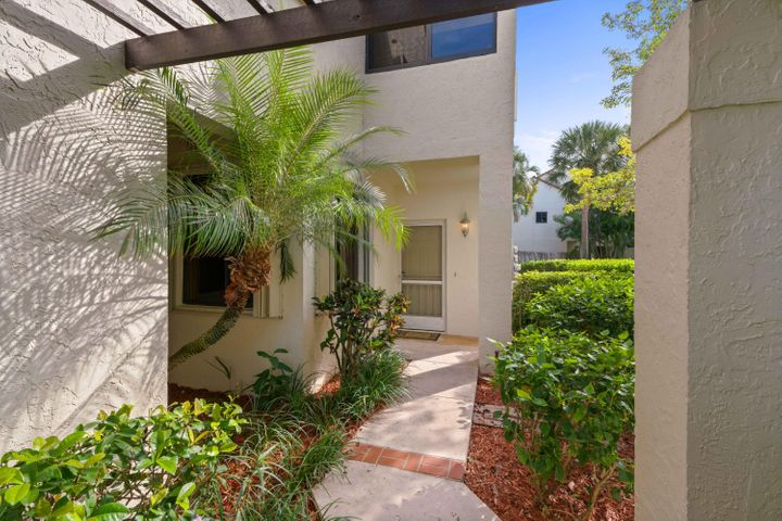 A charming and elegantly appointed first floor, end/corner unit with a lake view close to the beach at Sea Oats Community! Redone to the studs, this spacious condo includes a den, tile and marble flooring, granite, impact windows and sliding door, accordion shutters, plantation shutters, wooden finishes, wainscoting, crown molding, new plumbing, GE Profile dishwasher and stovetop oven, private laundry room, and attached 1-car garage with storage. AC 2014. Water Heater 2017. Own this unit as your new beach home or a perfect secondary/investment home and rent out for top dollar during season! Perfect location just minutes to the Juno Pier/Jupiter beach, Intracoastal Waterway, and local bars/shops. Community amenities feature a pool, tennis court, clubhouse, and on-site management.