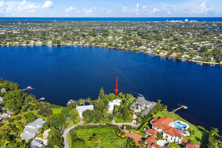 Rare opportunity! This authentic ''Old Florida'' estate lot is located in a secluded enclave of only a few homes on Bamboo Point on the Loxahatchee River. This private & peaceful property features expansive eastern exposure with nearly one-half acre (.42 acres) of land and 100' of water frontage. The natural beauty of the wide River views are breathtaking & the gentle breeze is amazing. Conveniently located near the Jupiter Inlet, this property is perfect for avid boaters. This is one of the last opportunities to build your dream estate on original prime property on Jupiter's Lox. River. Current home is a tear down.