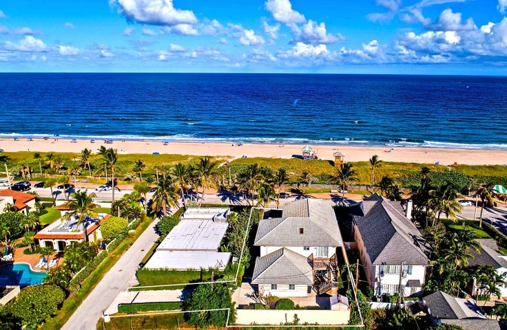 Offering the luxury of beachside living on Ocean Boulevard, directly across from the sands of Delray's world-class beach, this rare estate home commands unobstructed ocean views from one of the highest elevations on Delray Beach's barrier island, where the panoramic perspective focuses on the blue waters sparkling in the sunlight as the coconut palm trees sway in the balmy breeze.  Well-manicured grounds surround the five-bedroom residence, a modern interpretation of traditional design, gazing over the ocean from its perfect position atop a natural ridge, perched some 16 feet above sea level. Featuring comfortable living/entertaining areas on both levels, each served by a full kitchen, the flexible floor-plan gives added versatility to host extended family and/or large groups of friends.  On the main level, the more formal spaces open to a courtyard by the oceanside front terrace and impeccable lawns, where there is room for a pool in this gorgeous setting, having the drive and garage discreetly placed away at the back of the property.  Upstairs, the more casual spaces capture spectacular wide-open ocean views, extending up and down the coastline, from inside and outdoors on the relaxing verandah.  Here, the inspiring ocean scene is all the more breathtaking as the brilliant sunrise overspreads the morning sky, and as the moonlight dances on the water to create the backdrop for evening gatherings.  As one of the three bedrooms on this level, the master suite's calming oasis greets the day with an inspiring view of the ocean sunrise.  Directly across the street from this fabulous property, the sugar sands are an idyllic spot for lounging and sun-bathing, and the ocean beckons to world-class water sports.  A leisurely stroll along the pedestrian-friendly beach promenade leads to world-famous Atlantic Avenue, two blocks away, where the ocean meets the historic downtown heart of this charming village-by-the-sea, known for its boutique shopping, wonderful dining venues, 