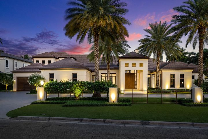 1788 Royal Palm Way or ''Casa Feliz'' is an Intracoastal dream home built by SRD Building Corp. on one and a half Intracoastal lots in the prestigious Royal Palm Yacht & Country Club Boca Raton's premier waterfront community. The estate evokes a sense of sleek and transitional style even before you enter the custom mahogany Tambour doors. The inside of the home is a phenomenal arrangement of custom wood sculptural room dividers, trims, and architectural finishes. The great room greets you with brightness and lavish elegance provided by the Corsica marble floors and the linear burner fireplace with a backlit green jade feature. The 8,510 sq. ft. open floor plan flows effortlessly from room to room and was conceived by award-winning P&H Interiors to host and entertain in a grand way. A generously-sized gourmet kitchen, complete with custom wood & glass cabinets, an onyx backlit backsplash, and two generous islands, creates the perfect space for cooking and casual entertaining.  The kitchen is accompanied by a formal dining area, which serves as an ideal destination for more formal affairs, and is serviced by a bar with an additional Sub Zero wine refrigerator. The floor plan also features His & Her dens, and a club room with a fully-equipped bar and cabana bath for additional relaxing and entertaining spaces. Casa Feliz features 3 zero-post corner sliding pocket doors and a retractable screen wrapping the whole perimeter of the covered patio, converting the master bedroom & the large family room to complete indoor-outdoor living. When ready, retract the screens and experience the home's outdoor living which is truly a resort-grade space. Along with the heated infinity edge pool and spa, there is a full summer kitchen with a grill, fridge, TV and wide array of bar seating in the summer room. Large palm trees tower over the limestone patio shading the pool during hot summer days, while a large firepit offers warmth during cooler evenings and nights. Convenient tablets throughout the home allow you to control the pool, house lights, security system, and moremaking it simple to enjoy both the indoors and outdoors at all hours. Finally, in addition to the beauty and privacy of the home, the second floor hosts a VIP guest wing. A private stairway and entrance lead to a fully-equipped kitchen, living room, en-suite bath with walk-in shower and closet. Two additional bedroom suites with access to the marble covered balcony reside on the second floor overlooking 150' of the Intracoastal waterway and backyard.
