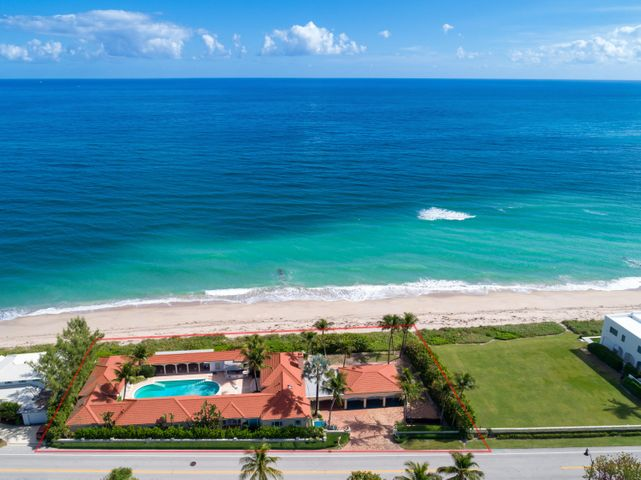 Trophy property in Palm Beach with 242' of ocean frontage. A rare opportunity to renovate and make your own beach compound.
