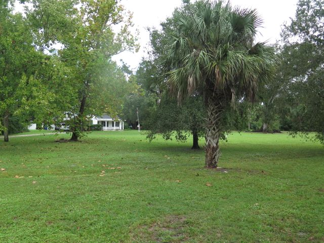 This is a view of the home from the front. You will note that there is a great large yard that provides plenty of room for kids to play or for you to use in whatever way you would like.