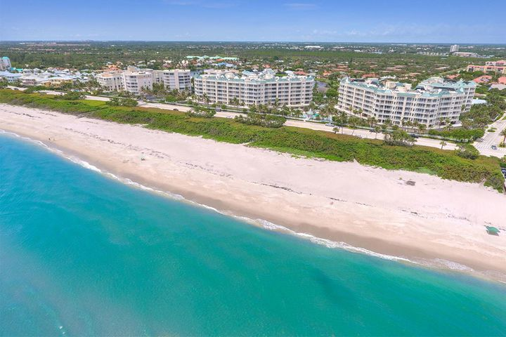 Spectacular 5th floor oceanfront condo located in the highly sought after Jupiter Ocean Grande community. You will be amazed at the endless turquoise blue ocean views from the moment you enter the front door throughout the entire living area & master bedroom. This luxury condo unit is professionally designed with upgrades throughout and features 3 bedrooms, 3 bathrooms, walk in closets, custom window treatments, gorgeous light fixtures, new cabinetry and quarts counter tops in the bathrooms, remarkable kitchen with granite counter tops and stainless steel appliances. This unit is open, bright, and in pristine condition. Amenities include a 24-hour manned gated entrance, resort style pool and spa, fitness center, club room, billiard room, tennis courts, card room, 2 covered garage spaces and storage area located on the same floor just outside the unit. Large dogs welcome. Close to fine dining and shopping. Pet friendly beach.