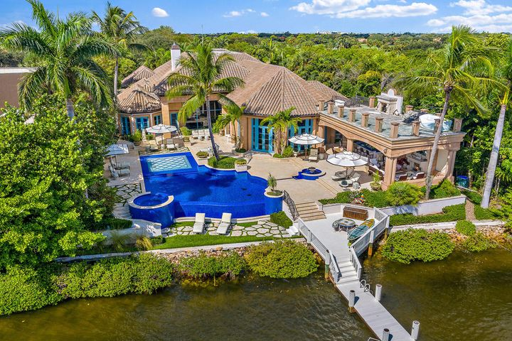 Intracoastal Masterpiece - This magnificent estate home has unobstructed view of Intracoastal and Preserve. Grand foyer entrance with Large slab marble floors, custom wood ceiling, Venetian plaster, extensive wood working, no expense was spared. 7 Bedrooms all with private full baths, including a fully equipped guest house with mini kitchen. The moment you enter the drive you know you have entered paradise. This home boasts the best of the best of everything... This home was rebuilt from the foundation up.  Truly a masterpiece.