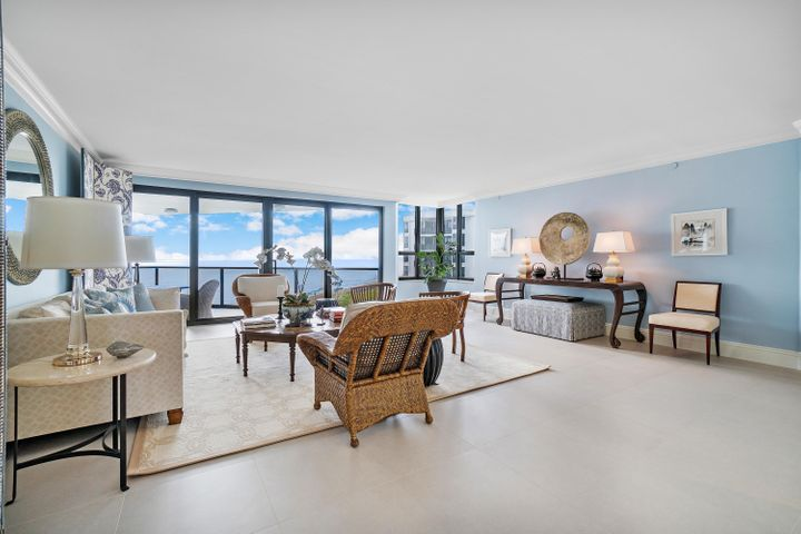 Spectacular Direct Ocean views from every room of this amazing, fully renovated apartment. Watch the sunrise and sunset from three balconies. 3 bedroom, 3 bathroom, 3000 sqft of interior space with 9 foot ceilings. The apartment was taken down to the studs to be reconfigured and redesigned by a top New York designer with no expense spared. Beautiful open chef's kitchen with top of the line appliances. Custom cabinetry in the kitchen, baths and offices. Spacious closets. All hurricane impact doors and windows. The apartment includes a boat slip for a 30 ft boat along with 2 garage spaces. The 3120 Condominium is a small luxurious building of 45 units with a 24 hour man gated security, beautiful common areas, fitness center, tennis courts, sundeck overlooking the wide beach, and beautiful pool. Close to Worth Avenue, fine dining, shopping and cultural centers.