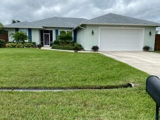 This 3BR/2BA plus a den and POOL home is light, bright & spacious and like NEW. Built in 2015. Designer touches throughout beginning with custom built-in bookshelves, tray ceilings and crown molding in bedrooms. Offers an over sized 19-1/2x24-1/2 garage w/ epoxy floor and a 7x16 under air storage room. Ceramic tile throughout, carpet in bedrooms. Living rm has full wall sliders that open to screened/carpeted porch. Kitchen has granite and ss appliances. Spacious master suite has 2 walk in closets, dual sinks and large sports shower. Ideal outdoor living on an over sized lot, fenced in with a heated pool on an enlarged cool top pool area and has a 10x20 Boat/RV pad. Other amenities are: gutters, security system, pocket doors, irrigation system, too many to list. This beauty won't last.