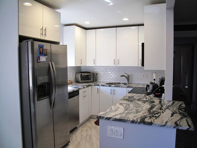 Fantastic completely remodeled 2BR/2BA 2nd floor condo w/lift close to front door. Parking is also right in front of building. Condo features: new AC 2019, Newly remodeled kitchen with granite counters, subway tile backsplash, SS appliances, new marble flooring throughout, neutral carpeting in both bedrooms, both bathrooms have been completely remodeled with every attention to detail. Make this condo your new piece of paradise. This community offer a courtesy bus, multi million dollar clubhouse w/cafe/rest,  gym, theater shows and so much more.  Enjoy Florida living at its best in this very active 55+ community where you'll find many planned social activities, enjoy game night, traveling, large heated resort style pool and clubhouse and so much more. Enjoy Florida living at its best in this very active 55+ community where you'll find many planned social activities, enjoy game night, traveling, large heated resort style pool and clubhouse and so much more. Located close to all amenities, just minutes to the beach and downtown Delray where you'll find, quaint shops, open air cafes, fine restaurants, shopping malls, theater, close to I95/Turnpike, Places of worship.   **All information is deemed reliable but not guaranteed and subject to change without notice. **