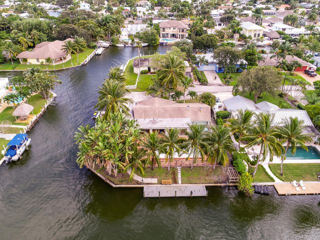 Rarely available CORNER WATERFRONT LOT in the heart of Jupiter! Build your dream home with over 225' of waterfrontage.   Located at the end of the cul-de-sac, just steps away from open views of the Loxahatchee River. Lot is approx. .28 of an acre. House is a tear down with demolition permit, dock and seawall permit in place. Seller has Floor Plans for a single story residence and is willing to share them with  the buyer. Don't miss this rare opportunity to build your DREAM HOME  Convenient to world class dining, shopping, championship golf courses, world class fishing and so much more and only 25 minutes to Palm Beach International Airport.  Call today for your place in paradise!