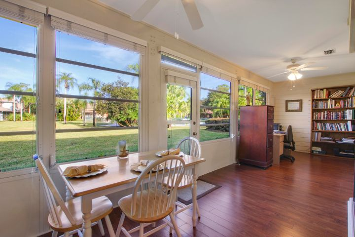 Additional room enclosure, with a beautiful view that is air conditioned, a perfect spot to enjoy the Florida Palms and even the community pool