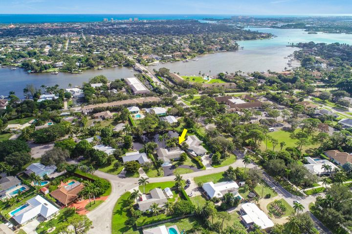 Location, Location, Location! Highly sought after community of Bermuda Terrace. This NO HOA community offers, boat docks, boat ramp, boat trailer parking and just a short golf cart ride to the Tequesta Country Club for all of you golfers & a great school zone for the children. There is a little of something for everyone. Updated home with 3 large bedrooms and 2 bathrooms. Beautiful kitchen with white shaker cabinets, marble like quartz counters and stainless steel appliances. Enclosed (screened lanai) large pool and tiki bar with running water and electric overlooking the peaceful pond and water fountain. Sellers will pay for a 1 year Social Membership at the Tequesta Country club with a full price offer, (Initation fee  & annual dues). Close to the beaches, Jupiter inlet and some of the best shopping and dining. All sizes are approximate.