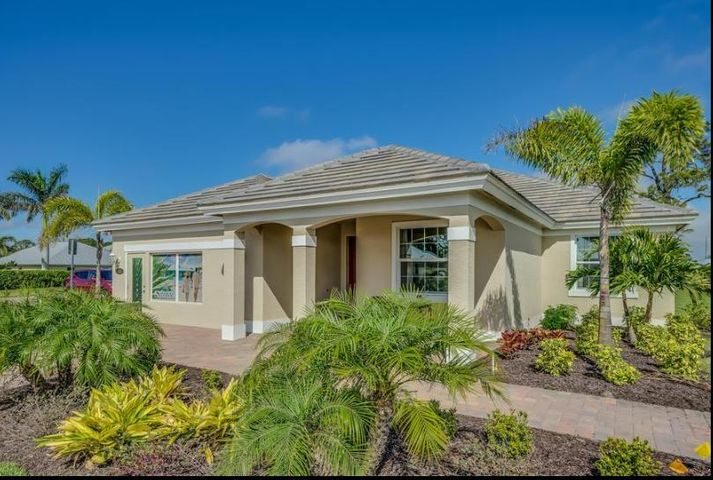 This GHO Home is the Alston SP. With 2 Bedrooms, Den, 2.5 Baths, 18x18 floor tile everywhere including the Bedrooms & Den, Crown Molding, Chandeliers, Ceiling Fan, Tile Roof, Impact Glass, Front & Rear Covered Porch and a Two Car Garage with a 12x12 Workshop! The Kitchen has off white Kitchen Craft cabinets, granite counter- tops, stainless steel appliances - including a 25 cubic inch Refrigerator. The airy Dining Room has a tray ceiling with two large windows on the side.