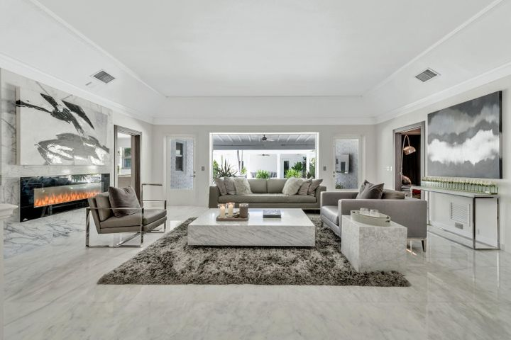 Stunning renovation in 2018 that is adjacent to to the world famous Mar-a-Lago Club. The Winter White House. This home includes a full membership to the Mar-a-Lago Club which is a one minute walk from the home and provides tennis courts, croquet, spa, fitness facilities, classes and ocean side dining. The property is extremely private, yet it is also within walking distance to the famous Palm Beach Island shopping and dining district, Worth Avenue. Large square lot, 13,504 square feet.The property includes deeded beach access and sits right in the heart of the estate   section of Palm Beach Island. This hidden gem is a once in a lifetime opportunity to live in this location. Annual rental option available for $35,000 a month. Expansion plans also included in the price.