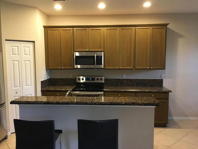 This beautiful townhouse located in Palm Beach Gardens has easy access to shopping, dining, I-95 is around the corner. Very cleanunit with a nice and simple layout. Ceramic tile downstairs and comfortable laminate flooring upstairs. Walk to over 25 restaurants, shopping and Roger Dean Baseball Stadium. Walk or jog around lake and sidewalks and bike paths. Safely bike to Timber Trace Elementary, Watson B Duncan Middle and Dwyer High and the prestigious Benjamin Private School. Concrete block construction, S-Tile roof and storm panels for entire home. 700 credit score or higher is required for community approval.