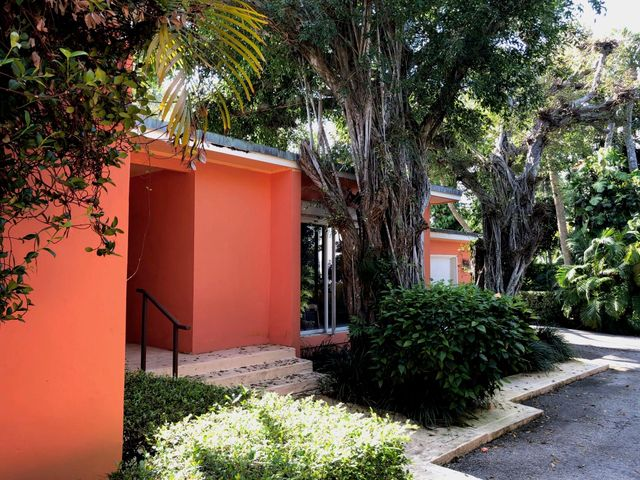 First time on the market in 35 years.   Renovate this 50's modern home or build new on the very private approx. 19,264 sq. ft. lot in the exclusive 11-home lake-block enclave of via Vizcaya, in the heart of the Estate Section.Design options may offer ocean views from the second floor and access choices from Vita Sirena.Current Survey & Elevation Certificate available.