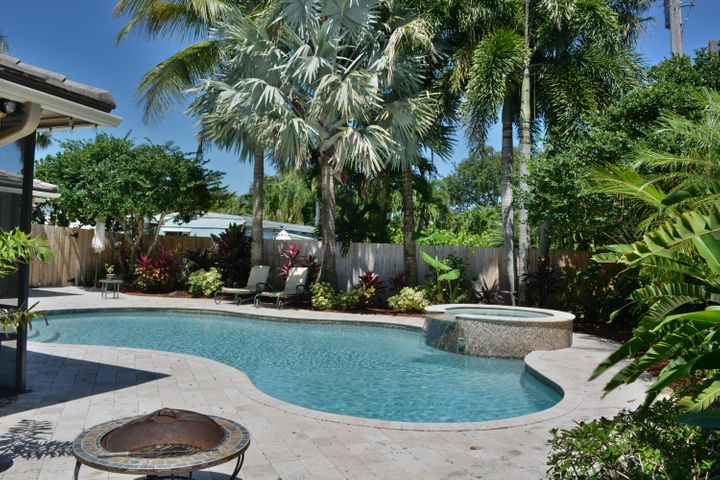 Available 1/20/2020 Enjoy living in your own tropical oasis in this stunning 3/3 Pool Home nestled in a private, landscaped setting, highlighted with the heated pool and waterfall spa.  This home is meant for entertaining family and friends with the beautiful kitchen featuring double ovens, granite and space to socialize as you flow into the formal dining room. There are plenty of updates throughout crown, granite hard woods, tile plantation shutters and more. The relaxing and entertaining does not stop there as you and guest can enjoy the huge family/ living room with formal bar that connects to a large covered lanai and outdoor kitchen.  You are now just steps to the lush private pool and spa area.