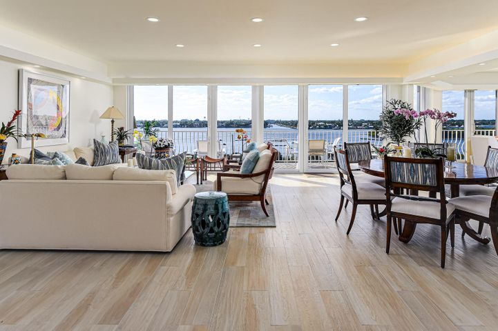 Tranquil and impressive intracoastal views are prevalent in this nearly-new spacious 3/2.5 with impact doors and 2 garage spaces. Light and bright with neutral finishes, its stunning kitchen and marble baths are top notch! Full service bldg. with direct beach access, tennis courts, fitness center, resort-like pool and much more.