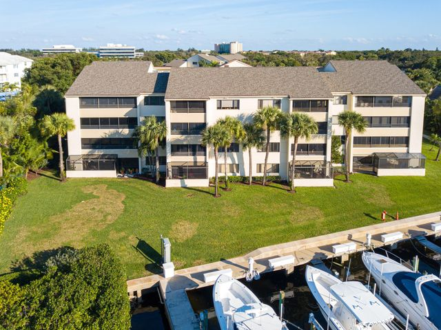 Spectacular DIRECT intracoastal water views from this stunning 2 bedroom and 2 bathroom waterfront condo.This condo is the  top floor of the building so this unit truly boasts soaring cathedral ceilings.  The condo has been beautifully updated with special attention to detail right down to the plantation shutters.  The kitchen is wide open to the living/family room and dining area and you can see the water views from from every area in the lining space.  The enclosed patio adds to the living space so just sit back, watch the boats go by and enjoy the views .  Oak Harbour is centrally located in Juno Beach and has a 24/7 manned gate.  There are 2 community pools , tennis courts, Clubhouse with a workout room and a social room. There are 2 day docks and the marina is very well protected.
