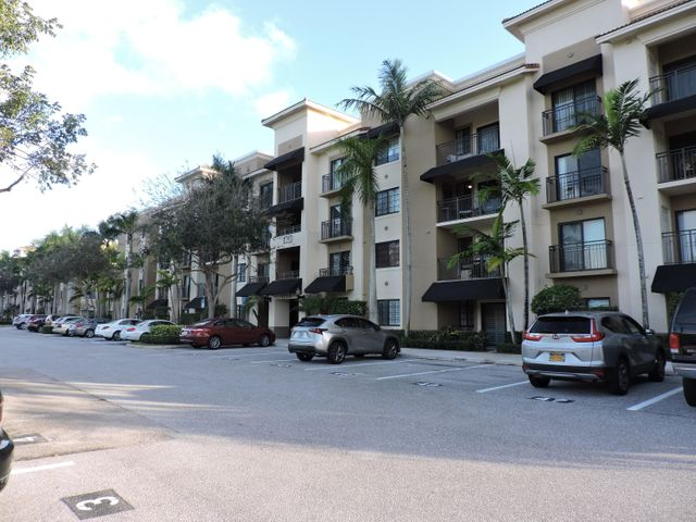 Location Location, This nice condo on 2nd floor with 2 bedroom, 3 full baths, 1,316 square feet under air, and office/den/bedroom (without closet) is located in heart of Palm Beach Gardens and community that has it all. Condo has carpet in bedrooms, wood flooring in main living areas. open kitchen with granite counter top,stainless steel appliances, in unit full washer & dryer, hurricane impact windows, comes with 1st floor parking spot in covered garage. Upscale community that is gated and all the amenities as large pool, spa, clubhouse, business center, kitchen, media room, fitness center, tennis court, manager onsite. Also the location is close to I-95, Florida turnpike, Publix grocery store, shopping at Downtown at the Gardens, mall, Legacy Place which all have fine dining or casual.