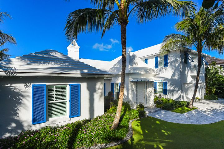 Built in 2015, this 4,808 square foot Bermuda-style home has incredible modern finishes throughout.  The living room has white Venetian plaster walls, a vaulted ceiling, and retractable doors that open to the large covered loggia.  The kitchen also opens to the loggia and is equipped with Miele appliances, a Sub Zero refrigerator, a large center island, a gas range, and a walk-in pantry.  Upstairs is the luxurious master suite.  Other features include a library, a Savant lighting system, Sonos speakers, reverse osmosis water treatment for home and pool, full hurricane impact doors and windows, a generator, and an air-conditioned 2-car garage.