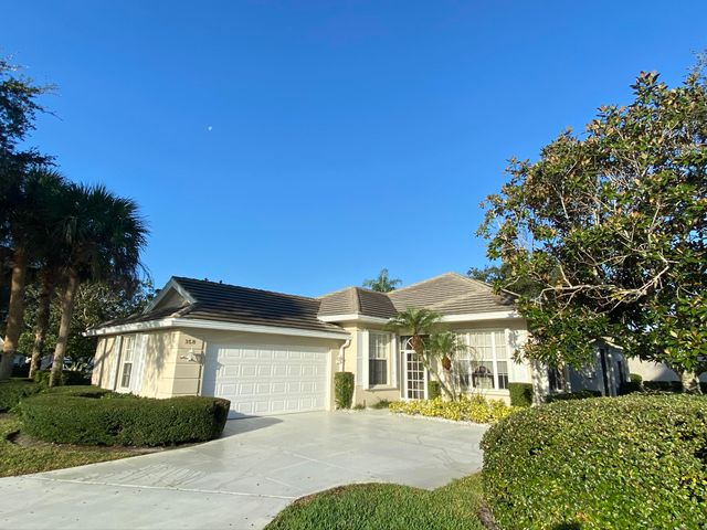 Come see this beautiful 3/2/2 DiVosta built, poured concrete home in the desirable Lakes at St. Lucie West!  Freshly painted exterior!  Your kitchen features granite countertops and newer stainless-steel appliances.  Master features lake views, his & her bathroom, and two huge closets.  Imagine relaxing with family and friends in your expanded Florida room overlooking a beautiful lake and private backyard.  Quiet neighborhood located in the heart of St. Lucie West close to I-95, Met's First Data Field, shopping, dining, and schools.  AC replaced in 2019.  Concrete tile roof replaced in 2011.  You will fall in love with this home; come see for yourself!  Owner is relative of Agent.