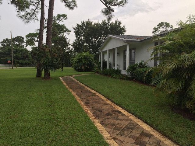 RARELY AVAILABLE 4/2 POOL HOME WITH NO HOA ON 1/2 ACRE LOT. BEAUTIFUL QUIET SETTING. BRING ALL YOUR TOYS AND PETS ALLOWED! 2 LIVING ROOMS, EAT-IN KITCHEN, 2 CAR GARAGE, HUGE POOL AND SCREENED ENCLOSURE. LIVE RIGHT IN THE HEART OF PALM BEACH GARDENS!