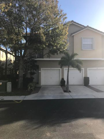 Located in the sought after City of Tequesta, this well-kept unit is move in ready and is offered fully Furnished! This second floor 2/2 features: stainless steel appliances, granite counter tops,  tile throughout (except stairs), full set of accordion shutters, impact garage door and walk in closet. AC replaced in 2017. Community Pool and patio area with covered cabana and playground. Walking distance to Restaurants and shops. Minutes by car to Jupiter Island Beach, Inlet and  Lighthouse. Don't miss your opportunity to live in Paradise!