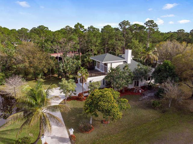 THIS IS A BREATH TAKING RARE GEM, LOCATED IN ONE OF THE MOST SOUGHT AFTER COMMUNITIES. JUPITER FARMS IS A DEDICATED EQUESTRIAN AREA. THIS AMAZING  4 BD/3 BA POOL HOME IS PERFECT FOR RAISING A FAMILY & ENJOYING FL LIFESTYLE UPDATED A/C , ROOF, PAINTING IN/OUT. KITCHEN GRANITE COUNTER TOPS,ISLAND, ALARM SYSTEM, DUAL SIDED FIREPLACE,BUILT-INS, FRENCH DOORS. WHEN IT IS TIME TO UNWIND LOOK NO FARTHER THEN THIS SPECTACULAR  2ND FLOOR BEAUTIFUL MASTER SUITE & MASSIVELY HUGE BALCONY,WHERE YOU CAN SIP COFFEE OVERLOOKING THE  LUSH & EXPANSIVE VIEWS OF  NATURE. THIS IS LUXURY LIVING AT ITS FINEST WITH SOARING CEILINGS, MARBLE FLOORING, LARGE SITTING ROOM, EXPANSIVE BATHROOM WITH BIDET, JETTED TUB, DORMER, SHOWER, CHANDELIER & DRY SAUNA  HUGE CLOSETS. A-RATED SCHOOLS4 MINUTES FROM TURNPIKE & I-95