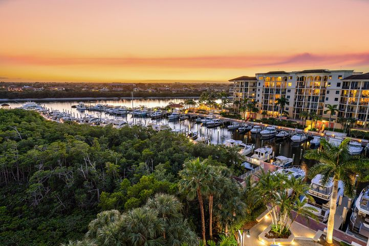 Views, Views, Views!!  The most expansive views in all of Jupiter Yacht Club.  With a wrap around balcony, this Penthouse unit captures breathtaking Direct Intracoastal views while overlooking the marina of Jupiter Yacht Club.  Capturing views of the bright blue Atlantic Ocean and the historic Jupiter Lighthouse, this Penthouse condominium truly feels like a home.  With Mahogany wood floors, upgraded baths, and a beautiful kitchen - this property is immaculate with custom detail throughout.  Enjoy all of the area attractions from the ease of the restraunts and shops at the Yacht Club to the boardwalk leading to Harbourside Place...all while only being a very short distance to one of the finest beaches in all of south Florida.  Location and views - this is a must see property!