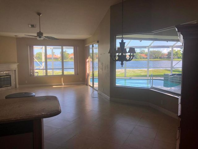 beautiful 1 story pool home with breathtaking lake views in gated community of Preston.  This home has 4 bedroom split plan with large family room and large screened patio.