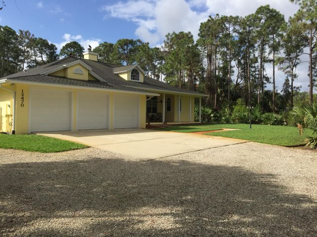 Beautiful 4330 sq ft home with 1500 sq ft in-laws quarters/apartment on 2.2 secluded acres on the desirable north side of Jupiter Farms. Main house has 3000 sq ft living space with 12 ft ceilings, 4 BR's, home office, family room, living room and dining room, 3 baths and 3 car garage. Pergo Natural Maple wood floors thru out and new carpeting in Master Bedroom. New LG SS appliances, fireplace, vacuum system and alarm system. Beautiful wood tile front porch, fully fenced with electric gate. Pool, pump, patio and screen enclosure redone. New roof, New A/C .New In-Laws quarters/apartment built 2017 detached from main house has 1000 sq ft living space, full kitchen with custom cabinets SS Whirlpool appliances, granite counter tops, 11 ft tray ceilings, alarm system and 2 car garage. Built in home office, large walk in closet and wood tile floors thru out. The information provided herein including but not limited to prices, measurements, square footages, lot sizes, calculations and statistics have been obtained and conveyed from third parties such as the applicable Multiple Listing Service, public records, owner, seller, as well as other sources. All information is subject to errors, omissions or changes without notice and should be independently verified by any prospect for the purchase of the Property. No guarantee, warranty, or representation of any kind is made regarding the completeness or accuracy of the information contained herein. Any prospective purchasers' use of any information is acknowledgement of this disclaimer and that the prospective purchaser shall perform their own due diligence. Prospective purchasers shall not rely on the information contained herein when entering into a contract for sale and purchase.  No Commissions shall be paid until Title Passes.