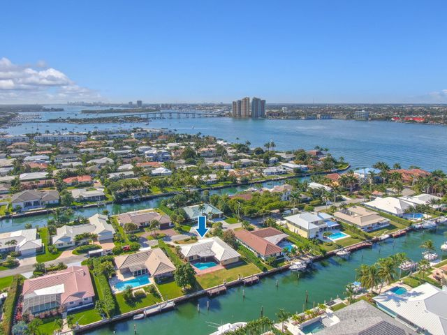 Great opportunity to renovate or tear down and start new. This lot boasts a depth of 130' with 90' of water frontage on a deep water canal with turning basin.   Ocean access, no fixed bridges and only minutes to the Palm Beach Inlet make this a highly sought after location.  Singer Island's beautiful beach is just a short walk away with neighborhood deeded beach access.