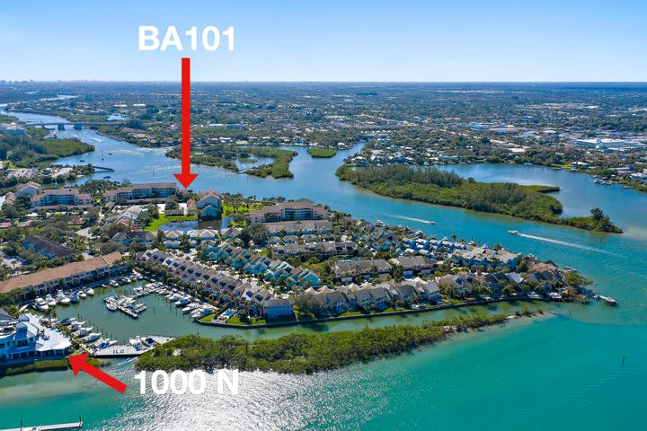 """Unique offering in Jupiter Harbour with a rich history. Designed specifically for the owner of the land prior to its development.  A two-floor condo with the look and feel of a townhome. No neighbors above or below! Prime location, most direct south view unobstructed all way to Indiantown Rd bridge and Fullerton Island. List of amenities is endless plus private courtyard/waterfall and stone walk-through & as you approach front leaded-glass french doors enter foyer exposing a hardwood curved staircase to 2nd level. More Starting on main level you enter an impressive office w/powder room could be used as a 4th bedroom if needed. Proceed to master bedroom to die-for. A solid impact glass- wall covered with plantation shutter for privacy from sitting area; additionally a Jacuzzi tub fit for a queen, double vanity, steam shower, double his-hers walk-in closet in addition to another closet for master of the house.... plus more... back to foyer and very private guest room w/ensuite full bath and private screened terrace with water view as well as the garden in front. Also has the full laundry room nearby recently remodeled.  Then take a gentle walk up the stairs to vaulted ceiling, extravagant living room w/gas fireplace, Impact glass door to the terrace totally retractable into the wall.  Unique feature you can exit 2nd level to the walkway to elevator if necessary via yet again another wall of leaded glass and screened area overlooking the garden/waterfall below. Level 2 formal dining room, brand new kitchen/bfast area, plus another den/bedroom fondly called """"Jungle Room"""" with full ensuite bath and access to its own screened terrace overlooking waterway and large window over the garden PLUS 1 MORE powder room. Unit comes with l covered parking plus 2 Reserved open spaces. Visit the Jupiter Harbour Condo Assoc. website for Community amenities. Imagine 98 units on 11 acres of waterfront spaciousland not comparable anywhere else in the area."""