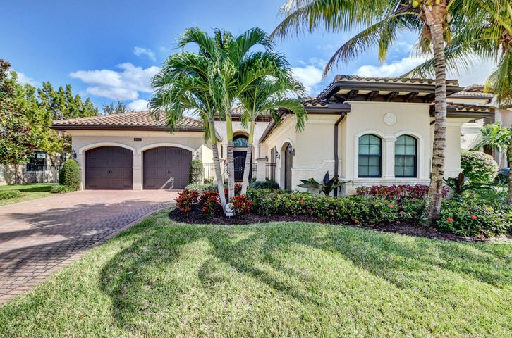 Sleek and sophisticated best describes this ''Victoria ''model home  sited on a waterfront lot with pool in the  gated community of the Bridges. Features: 3 bedrooms, 3.5 bathrooms, 3 bay garage.  Pavered drive, walkway and decorative gate leads to the impressive entrance. Greet guests in the grand foyer. Spacious great room overlooks the patio, pool and lake beyond. Elegant formal dining room for those special occasions. Gourmet island kitchen with quartz counters and morning room. Grand master suite, lavish master bath with separate shower, dual sinks, European tub. Two ensuite guest bedrooms, guest powder room,family/media room perfect for indoor relaxing.  Resort style pool and expansive  patio is ideal for casual entertaining.  Laundry room and 3 garage bays complete this showplace. electric shades throughout. High impact windows and doors. Recessed lighting, coffered ceilings. Wet bar. Kitchen island. Gas stove. Porcelain floors throughout.