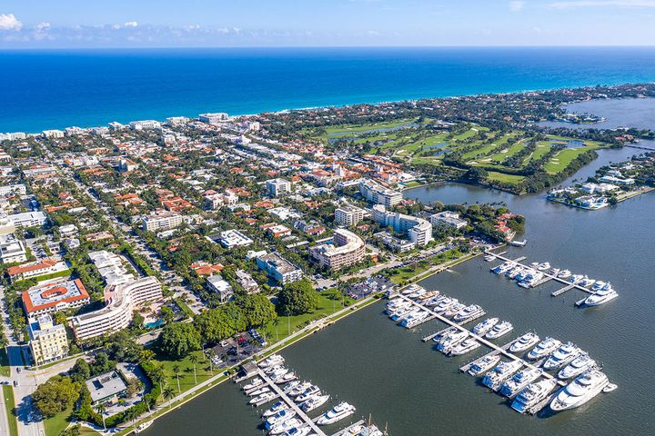 Relish the lovely lagoon water views from the living room, both bedrooms and the office area of this spacious, elegant apartment with high ceilings and parquet wood flooring.  Features partially updated en-suite bathrooms, marble countertops in kitchen,  washer\dryer, Miele appliances and motorized window shades.  Popular full service building in prime location, only one block from Worth Avenue, restaurants and world class shopping.  Pet friendly, full time doorman, pool, bike storage.  .  Another nice feature is you enter apartment from outside hallways without going through the building.