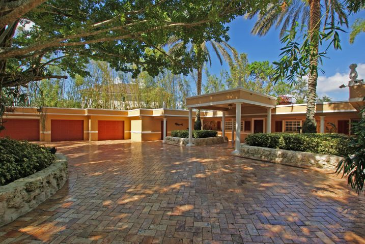 This home is truly a one-of-a-kind property on the widest part of the Loxahatchee River. Pass through the gated entrance and down the long, winding driveway to your own personal paradise! The 3BR+den/3Bth/3-car garage home is in pristine condition and features hardwood floors, chef's kitchen, formal dining room, built-ins and huge, covered patio with summer kitchen! The home site is over an acre in size and features approximately 30,000 stalks of bamboo grass and a Turkish stone driveway bordered by coquina stone. Additional highlights of the property include a pirate ship tree house, putting greens, 2 orchid houses, a workshop, outdoor bathroom, archery area, massage area, generator shed, beach area, spa tub overlooking the river and a fully equipped dock with 2 lifts.