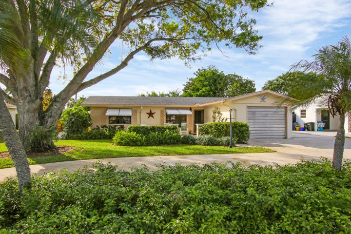 Beautifully landscaped. Large circular driveway with large pad on side of home -- perfect for R V or Boat etc