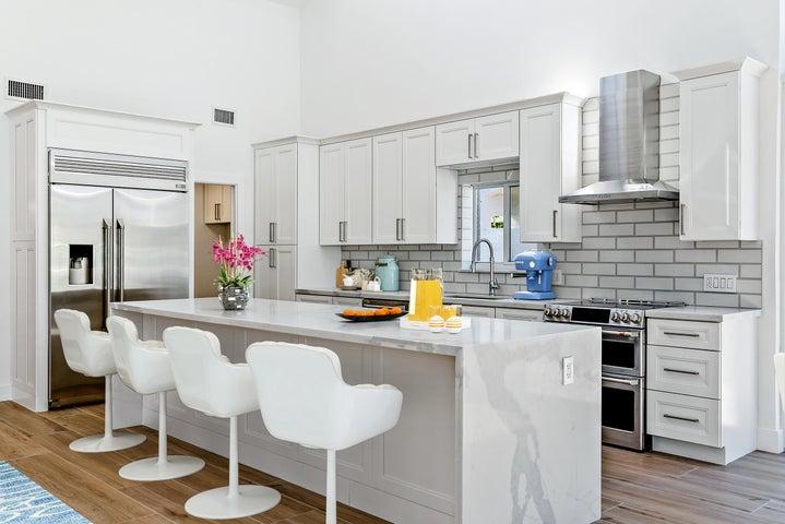 Brand New Kitchen with Calcutta Quartz and GE Monogram Stainless Steel Appliances