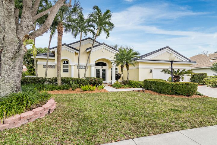 DO NOT MISS this immaculate CBS, 4 bedroom, 3 full bath, 2-car garage, Rutenberg pool home in the highly desirable north passage of Jupiter. Enjoy this updated home on a quiet street with a cul-de-sac. Superior improvements include:  new hurricane impact windows (2019); new roof (2020); AC (2018); resurfaced pool & lanai; stone pavers; beautiful porcelain wood-look tile floors throughout; crown molding & updated baths. The open-concept, eat-in kitchen offers granite counter tops, glass backslash, two pantries, prep island & large breakfast bar. The bright & roomy family room includes a custom built-in entertainment center wired for sound. The spacious master suite opens to & has lovely views of the lanai & pool area. The sizable master bath includes custom maple cabinets, granite counter tops, dual sinks & doorless shower. There are stunning, high-end window treatments throughout this home. The large open floor plan with sliding doors completely opening to the lanai & summer kitchen is perfect for entertaining. The separate laundry room includes a sink & folding area. The recently fenced yard includes mature oaks & beautiful palms. Enjoy low Martin County taxes while being minutes away from all Jupiter has to offer including beaches, shopping, restaurants, theater & golf. The nominal HOA fees of $37 per month provide upkeep for common areas, tennis, basketball courts, sidewalks, etc. The Moorings in Jupiter is convenient to I-95, Florida turnpike, Jupiter inlet & wonderful beaches. North passage's proximity to waterways provides year round wonderful breezes.