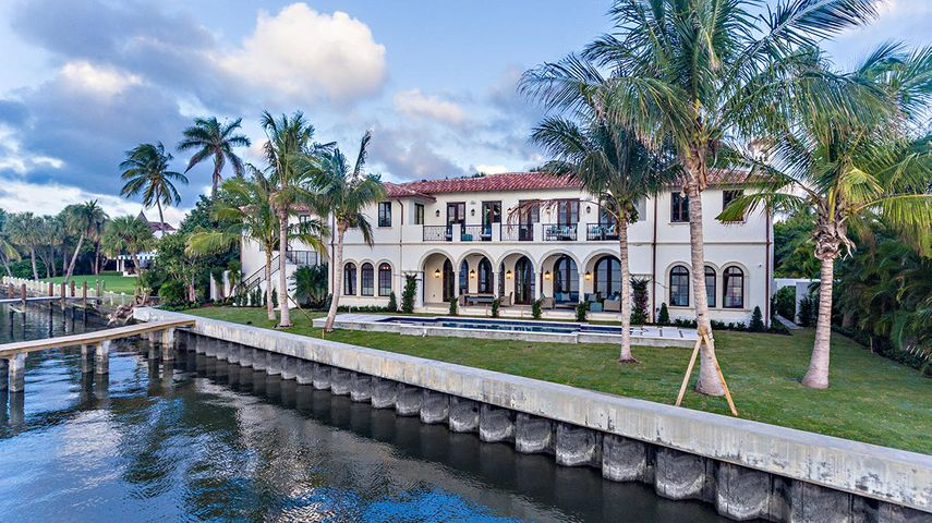 This stately newly constructed house boats over 7,100 SF living space. The interior space is comprised of 4 bedrooms, 5 baths and 2 half baths. This estate is ideal for formal and informal entertaining. The expansive outdoor covered loggia has plenty of room for dining and living spaces overlooking the pool and 155' of direct Intracoastal frontage. The house features an elevator, downstairs and upstairs laundry, new dock with electric and water; large enough for a 90+/- foot boat, 5 AC zones, security cameras throughout and a full house generator.