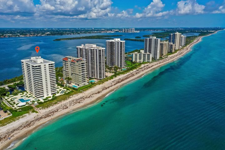 MAGNIFICENT OCEAN AND INTRACOASTAL views from this South facing corner unit on the 16th floor.  Only one of two floors in this building with nine-foot ceilings!  Custom kitchen cabinetry w/soft touch+oversized island+stainless steel appliances.  Crown molding+beautiful oversized ceramic tile in kitchen & main living area+new Maytag W/D w/10 yr warranty. Water views from every room, beautiful west twilight views on sunset.  24 hr manned guard gate+onsite manager+New pool deck+summer kitchen+gorgeous new social room+gym w/ocean view.  Reaches is an understated elegant world class building, One of the few BEST KEPT SECRETS on Singer Island.  Come and take a look.......